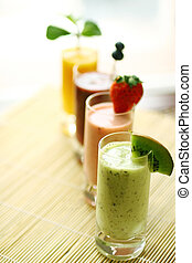 Colorful smoothie - Row of colorful smoothies with fresh...