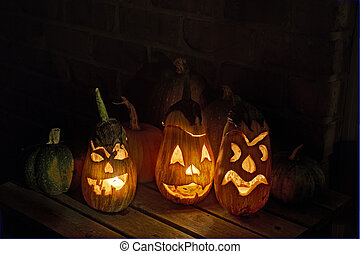 Squashes and carved eggplant lanterns at halloween - HDR...