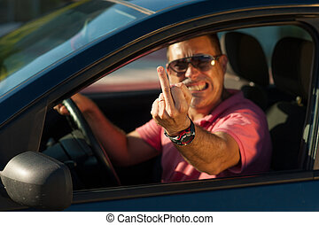 Very agressive driver. - A very agresive driver in his car.
