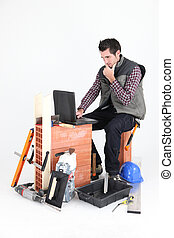 Bricklayer with a laptop