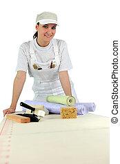 Woman ready to wallpaper