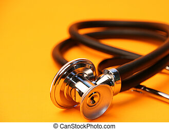 Stethoscope on Yellow - A stethoscope currled on a yellow...