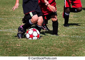 Little Kids Soccer Game - Little kids run around the soccer...