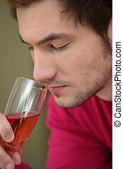 Man smelling glass of wine