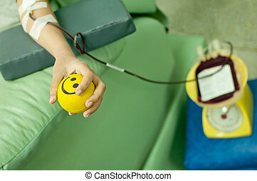 a donor donates blood at hemotransfusion station - a donor...