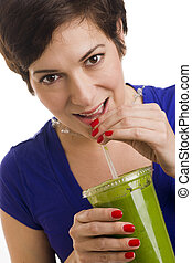 Woman sips Green Smoothie - Beautiful woman with manicured...