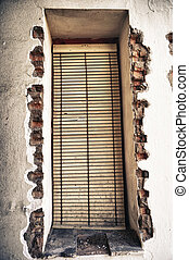 old windows blinds - Abandoned facade with wood windows in...