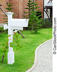 mail box - white wood mail box in the garden