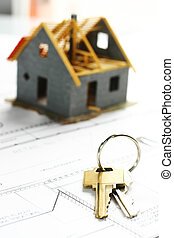 Buying a new house - New house and a set of keys on a...