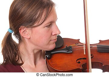 Violinist - Portrait of a young woman playing violin on...