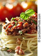 spaghetti bolognese - closeup of a fresh italian spaghetti...