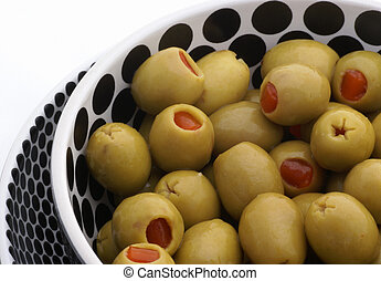 Green olives in bowl with dots.