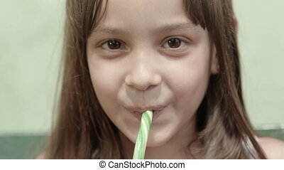 Portrait of female child with candy - Portrait of cute...