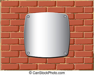 Metal shield on the brick wall