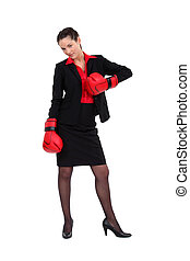 Attractive businesswoman with her punching gloves