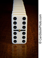 domino effect - financial and political concept illustrating...
