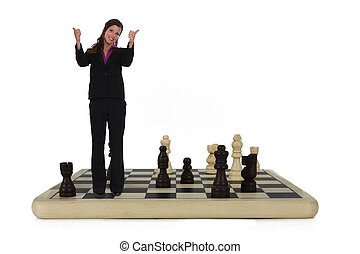 Businesswoman standing on chess board