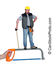 Worker standing on a hacksaw