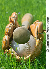 Softball Stuff - An end view of a ball, glove and bat laying...