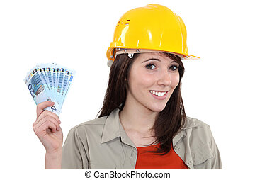 Young handy woman holding wage