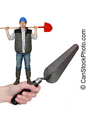 Manual worker with shovel