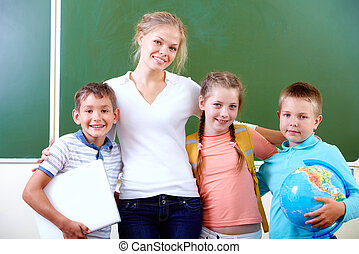 Teacher and schoolkids - Portrait of cute schoolchildren and...