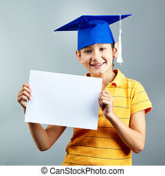 Smart pupil - Portrait of happy boy with blank paper looking...