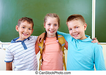 Adorable schoolmates - Portrait of lovely girl and two...