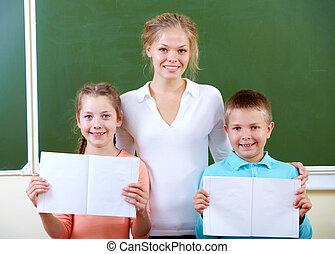Teacher and schoolkids