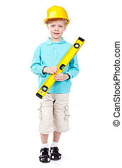 Constructor - Cute boy in hardhat holding a level and...