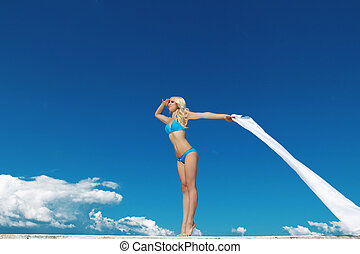 Beautiful young woman over the blue sky with white tissue