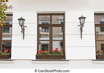 Facade of shop with windows and flowers pots