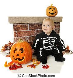 Tiny Skeleton Among Pumpkins - An adorable baby skeleton...