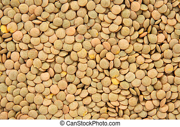 Green lentils background Abstract food textures