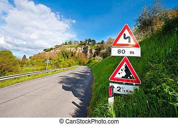 Road Signs - Shade of the Road Signs on a Paved Road In...