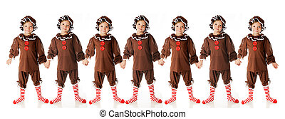 Seven Happy Gingerbread Girls - A string of seven cute,...