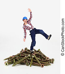Woman balancing on pile of screws