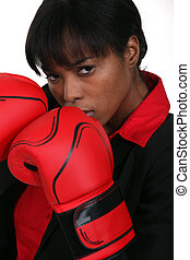 Furious businesswoman boxing