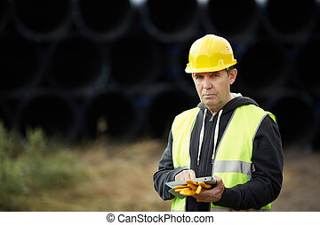 construction worker using digital tablet - builder with...