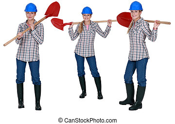 Woman standing with shovel