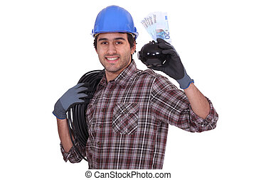 Worker with piggy bank and bills
