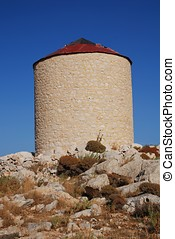 Old windmill, Halki island - An old stone windmill on the...