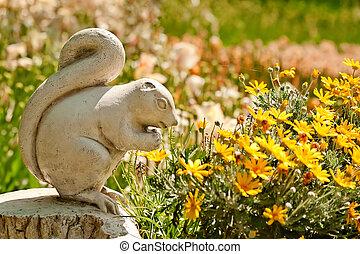 A Cute Stone Chipmunk Statue