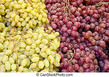 A Bunch Of Fresh Organic White And Red Grapes - At A Street...