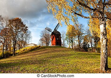 Old windmill during autumn at Korskullen in Soderkoping,...