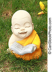 Statue of smiling novice