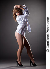 Sexy youn girl show striptease in white shirt