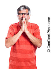 Pensive senior man praying
