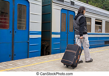 Walking passenger on a train station - Young man with a...