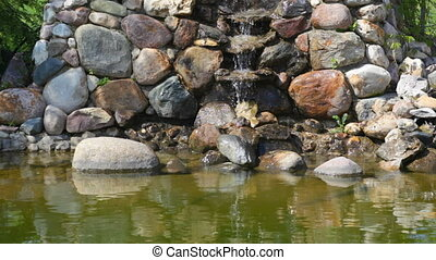 Small falls flowing on stones